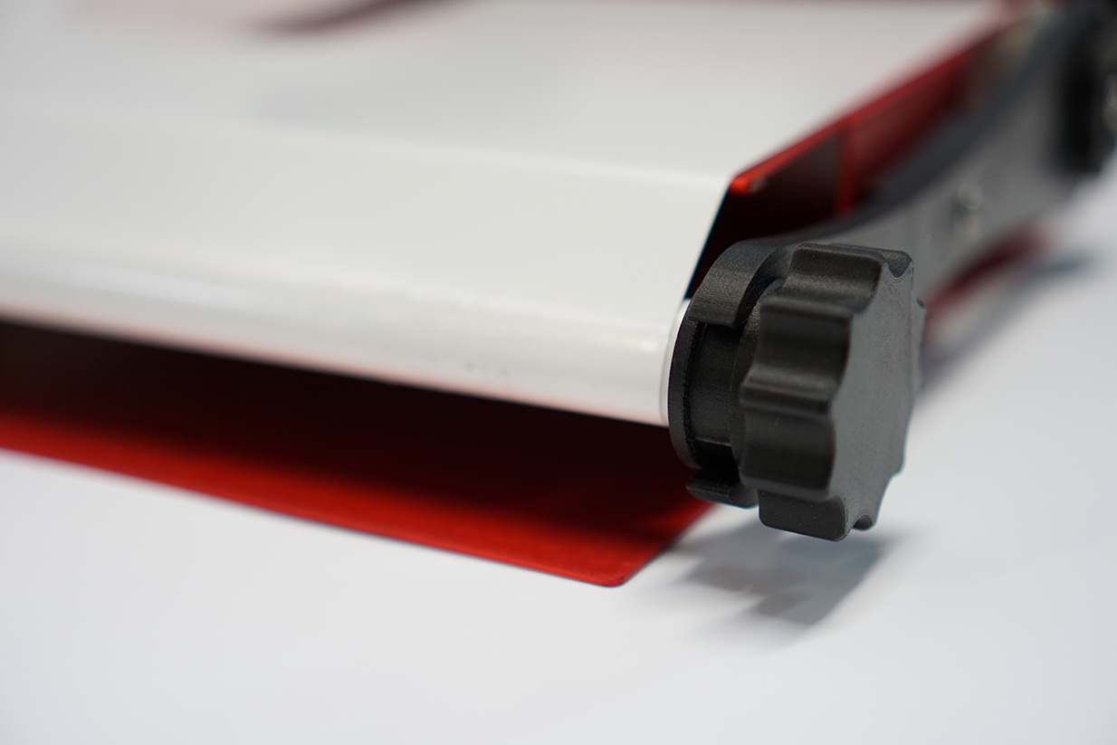 Upon saturation of the adhesive with particles, the robust grip is simply turned to 'wind' the used adhesive on to the roll, thus exposing a clean fresh adhesive surface image